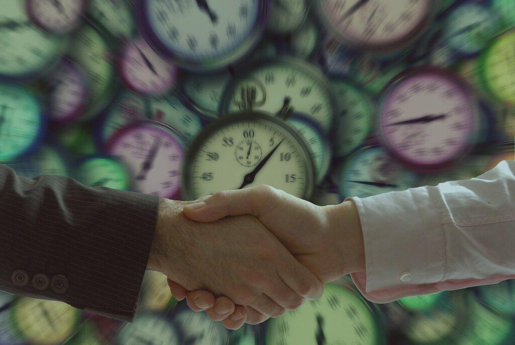 handshake, businessmen, clock